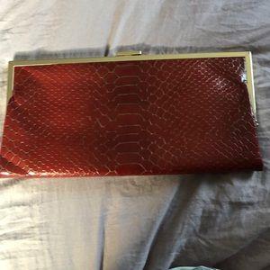 Rustic snakeskin like HOBO clutch bag